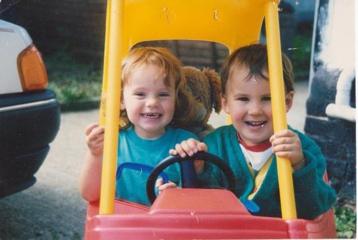 Image of Tom and Rach in play car